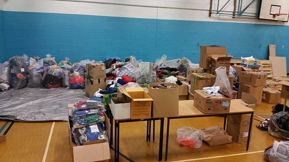 Refugees START The Huge Donation Pile